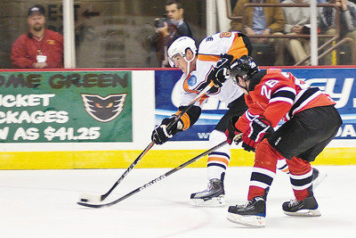 Phantoms Mike Testuwide fights for control of the puck with Albany Devils player Dan Kelly during their game Saturday night. Photo Eric Jenks 10/16/10