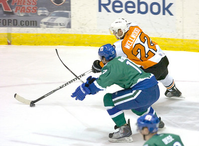 Connecticut's Ryan McDonagh tries to stop Adirondack's Eric Wellwood during Wednesday's AHL game in Glens Falls. Ed Burke 12/15/10