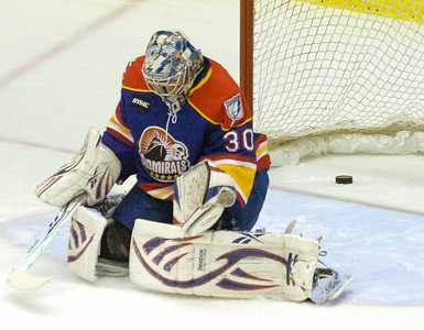 Norfolk goalie Cedric Desjardins hangs his head after failing to stop a shot by Adirondack's Danny Syvret during Friday's AHL game in Glens Falls. Ed Burke 11/26/10