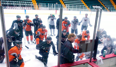 Adirondack Phantoms Head Coach Greg Gilbert  coaches his team on their first day of ice practice at the Glens Falls Civic Center, Friday will be their preseason exhibition game against the Albany Devils. Photo Erica Miller 9/29/10 spt_Phantoms1_Thurs