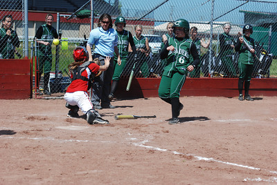 José Quezada/For the Times-Standard  #6 SBscores on a wide throw to the Ferndale catcher.