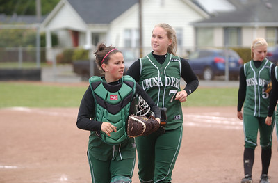 St. Bernard's Hayley Stevens, left, and Haylie Chase, center, trot off the field after the Crusaders' 3-0 win in game two of Saturday's twinbill against Hoopa Valley.
