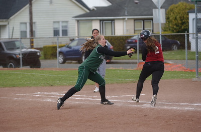 St. Bernard's Haylie Chase, left, tags out Hoopa Valley's (2) on the first base line during game two of Saturday's doubleheader.