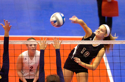 As teammate Siena Wilder looks on, BHBL's Kathleen Schurman spikes the ball at the net during the Spartans second game against Walter Panas during state playoffs Saturday in Glens Falls. Ed Burke 11/17/12