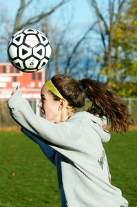 Mikayla Gowett heads the ball while warming up with her sister Madison both starters for the Mechanicville's girls soccer team. Photo Erica Miller 11/5/12 spt_Sisters2_Tues