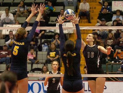 BHBL's Lynsea Hensel spikes the ball into defense by Walter Panas' Brigitte (5) and Ciara Clauss during state playoffs Saturday in Glens Falls. Ed Burke 11/17/12