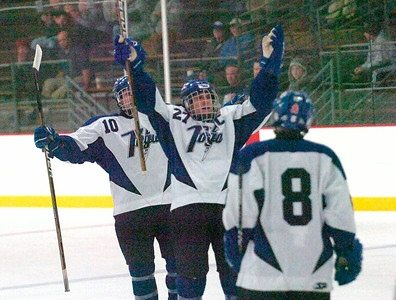 Saratoga's Devin Smith (27) celebrates with teammates after scoring a goal over Queensbury during Wednesday's scrimmage at Saratoga Springs Ice Rink. Ed Burke 11/14/12