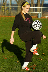 Madison Gowett warmed up with her sister Mikayla both starters for the Mechanicville's girls soccer team. Photo Erica Miller 11/5/12 spt_Sisters3_Tues