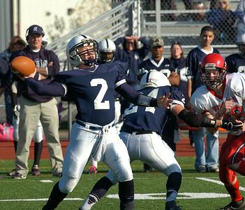 Rensselaer quarterback Steven Harwood throws against Moriah during Saturday's regional playoff at Schuylerville High School. Ed Burke 11/10/12