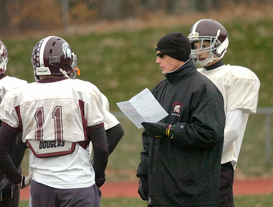 Burnt Hills-Ballston Lake head coach Matt Shell talks with quarterback Ryan McDonnell (11) during Thursday's practice at BH. Ed Burke 11/8/12