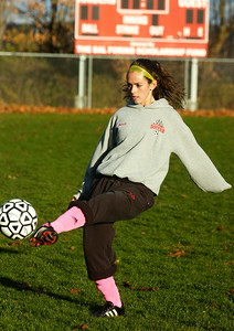 Mikayla Gowett  warming up with her sister Madison both starters for the Mechanicville's girls soccer team. Photo Erica Miller 11/5/12 spt_Sisters4_Tues