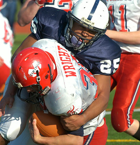 Rensselaer's Seth Butler takes down Moriah's Cameron Wright during Saturday's regional playoff at Schuylerville High School. Ed Burke 11/10/12
