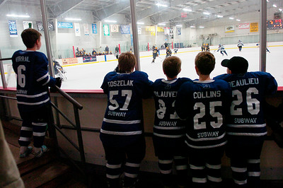 Saratoga Youth Hockey players watch Wednesday's scrimmage between Saratoga and Queensbury varsity teams at Saratoga Springs Ice Rink. Ed Burke 11/14/12