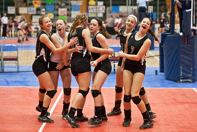 Burnt Hills-Ballston Lake volleyball teammembers celebrate after a hard fought point during the match against Pittsford Sutherland Sunday Afternoon NYSPHSAA Tournament at the Glens Falls Civic Center. Photo Eric Jenks 11/18/12