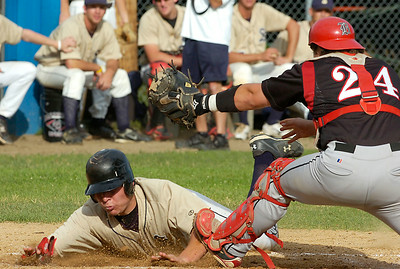 Amsterdam Mohawk catcher Matt Colantonio tries for the tag as Saratoga Phillie JoJo Sharrar is safe at home after a 5th inning triple by teammate Adam Dimino during Friday's double header at East Side Rec. Ed Burke 7/3/09