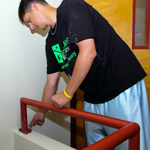 Saratoga Phillies player Zach Hartman, Siena College Sophmore and Ballston Spa native, peels away tape from a freshly painted area Wednesday at the Franklin Community Manor in help with the Rebuilding Together program. Click here to read the article. Photo Erica Miller 6/17/09 news_PhilliesBuild_Thurs