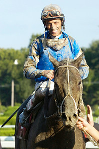 John Velazquez, atop Pyro, enters the winners circle after winning the 30th Running of The Forego at the Saratoga Race Course Saturday afternoon. Photo Erica Miller 9/5/09 spt_Forego1_Sun
