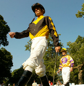 Jockeys Jamie Theriot, left, and Julien Leparoux enter the paddock for Thursday's 8th race, The Riskaverse, which was won by Ramon Dominguez aboard Silver Reunion. Ed Burke 9/3/09