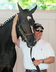 Assistant Trainer Scott Blasi schools Rachel Alexandra in the Paddock at the Saratoga Race Course in preparation for the Woodward Stake Race on Saturday afternoon. Photo Erica Miller 9/3/09 spt_RachPaddock2_Fri