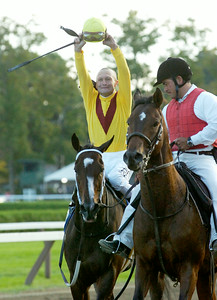 Calvin Borel, atop Rachel Alexandra, raising his arms in cheering of winning the 56th Running of The Woodward Saturday afternoon at the Saratoga Race Course. Photo Erica Miller 9/5/09 spt_WoodWard2_Sun