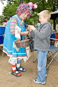 Ryan Sala picks his nose from clown Ida No (Theresa Stevens) during family fun day at the track sunday. photo Eric Jenks 9/5/10