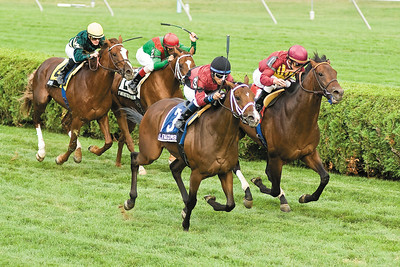 Jockey Alan Garcia takes the outside with Leathal Combination to win the Grade III Saranac sunday at the Saratoga Race Course. Photo Eric Jenks, 9/5/10
