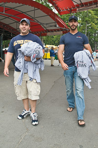 "Rodney Lavarnway and Kyle Kowalowski take home an armful of t's each from NYRA's Sunday Giveaway. ""I've been coming to the track for the give away since I was 12,"" said Lavarnway. Photo Eric Jenks 9/5/10"