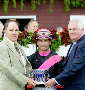 Trainer, of Here Comes Ben, Charles Lopresti, Jockey Alex Solis, and NYRA CEO and President Charles Hayward in the winners circle after the winning of the 31st Running of The Forego Grade 1 Saturday afternoon at the Saratoga Race Course. Photo Erica Miller 9/4/10 spt_Forego3_Sun