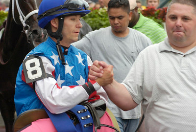 Jockey David Cohen and trainer Mike Tannuzzo congratulate each other after longshot Count Catamount won the 7th race. Ed Burke 9/3/10