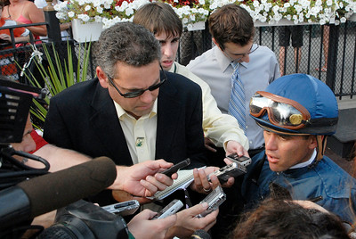 Javier Castellano is interviewed by media after winning The Personal Ensign Invitational Stakes Grade 1 with Ask the Moon on Saturday at the Saratoga Race Course. Photo Erica Miller 9/3/11 spt_PerEnsign2_Sun