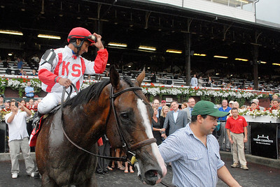 Rajiv Maragh is led around in the winners circle atop Currency Swap after winning the Three Chimneys Hopeful on Monday at the Saratoga Race Course. Photo Erica Miller 9/5/11 spt_ThreeChimney2_Tues