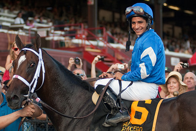 Emcee and jockey Alan Garcia in the winner's circle after the Forego Grade 1 Saturday afternoon at the Saratoga Race Course. Photo Eric Jenks 9/1/12