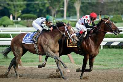John Velazquez and To Honor and Serve edged out Mucho Macho Man and jockey Mike Smith for the win during the Woodward Grade 1 Saturday evening at the Saratoga Race Course. Photo Eric Jenks 9/1/12