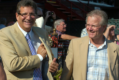 Belmont Child Care Association Chairman Michael Dubb, left, and trainer Bill Mott share a laugh in the winners circle after Mott's Lunar Victory carried jockey Junior Alvarado to a win in Thursday's 7th race. Ed Burke 8/23/12