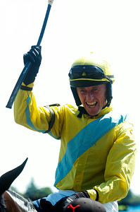 Robert Walsh raises his whip in cheers after winning the 71st Running of the New York Turf Writers Cup on Thursday afternoon at the Saratoga Race Course.Photo Erica Miller 8/23/12 spt_NYTurfWriters3_Fri