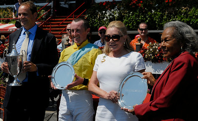 (L-R) Trainer Richard Valentine, jockey Robert Walsh, Jacqueline Ohrstrom and Rachel Robinson in the winners circle after winning the 71st Running of the New York Turf Writers Cup on Thursday afternoon at the Saratoga Race Course.Photo Erica Miller 8/23/12 spt_NYTurfWriters4_Fri
