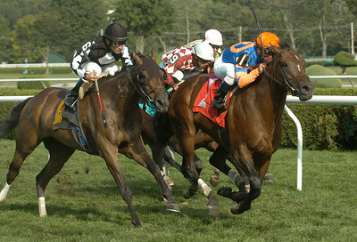 Isn'tlovejustgrand and Javier Castellano (1) head for a win in Friday's 8th race. Ed Burke 8/24/12