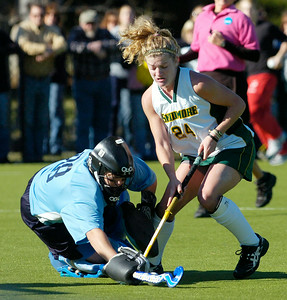 Skidmore's Christine Kemp is stopped by The College of New Jersey goalie Shannon Syciarz  during Saturday's NCAA Divison III field hockey semifinal. Ed Burke 11/13/10