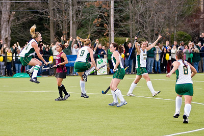 Skidmore's field hockey team jumps with joy after a goal Sunday in their win against Eastern. Photo Eric Jenks 11/14/10