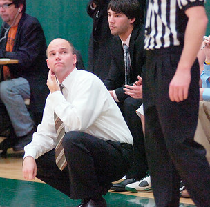 Skidmore College mens basketball coach Joe Burke glances at the scoreboard showing a 31-31 tie near the end of the first half during Tuesday's game versus Hartwick. Ed Burke 11/29/10