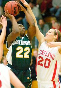 Skidmore's Ismatu Alison-Konteh is fouled on her way up by Cortland's Megan Maycomber during Saturday's 33rd Annual Skidmore College Women's Invitational Toyrnament. Ed Burke 11/20/10