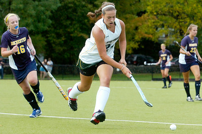 Skidmore's Sam Skott racing down the field with the ball with Rochester's Darragh Kerr shortly behind  during their field hockey game Saturday afternoon. Photo Erica Miller 9/24/11 spt_SkidRoch2_Sun