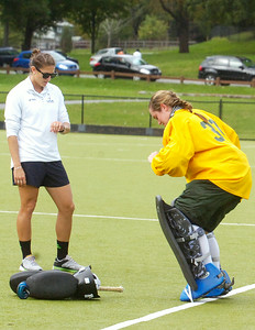 Saratoga Springs High School graduate and now Skidmore student Haley McDoughall quickly stretches with Assistant coach, and also Saratoga Alumni, Elise Britt before the second half of their field hockey game against Rochester on Saturday afternoon. Photo Erica MIller 9/24/11 spt_McDoughall2_up