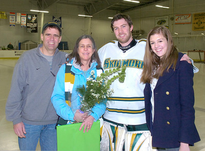 Skidmore senior Colin Bessey stands with his parents David and Kitty and sister Katherine at Saratoga Springs Ice Rink Friday night.  Seniors on the Men's hockey team were honored prior to Friday's ECAC matchup against Castleton State at Saratoga Springs Ice Rink. Ed Burke 2/17/12