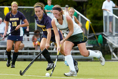 Skidmore's Caylyn Sillivan race down the field against Rochester's Allison Resnick during their field hockey game Saturday afternoon. Photo Erica Miller 9/24/11 spt_SkidRoch3_Sun