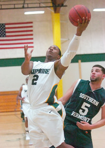 Skidmore's Terron Victoria goes up for a shot as Southern Vermont's Jordan Santiago looks on during Tuesday's game at Skidmore. Ed Burke 11/22/11