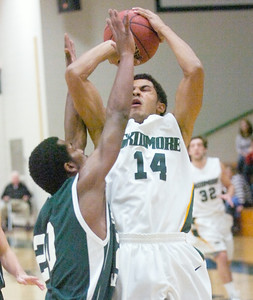 Skidmore's Eli Johnston goes over defense by Southern Vermont's Avery Mitchell during Tuesday's game at Skidmore. Ed Burke 11/22/11