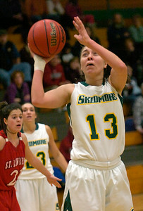 Skidmore's Logan Frederick  tries for two during Tuesday's basketball matchup against St. Lawrence. Ed Burke 1/24/12
