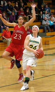 Skidmore's Jessie Kavana eyes the basket as St. Lawrence's Erica Spera goes up to block during Tuesday's basketball matchup at Skidmore. Ed Burke 1/24/12