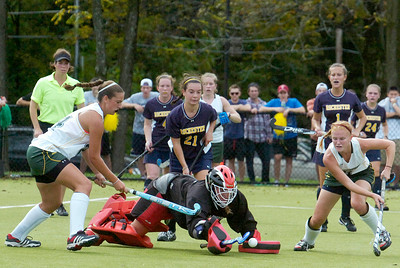 Skidmore's Kelly Blackhurst (9 right) and Sam Skott (left 24) take a shot at Rochester's goalie Madison Wagner as she dives for the ball during their field hockey game Saturday afternoon. Photo Erica Miller 9/24/11 spt_SkidRoch1_Sun